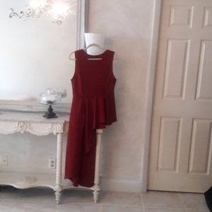 Asymetrical red tunic peplum top